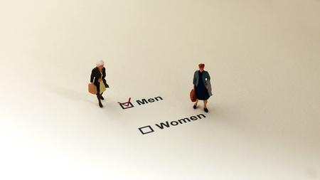 Men and Women check boxes with red check mark in the men box. The concept of restriction on women in society.