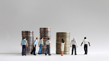 Foto de Contemporary concept of economic activity. Pile of coins and busy walking miniature people. - Imagen libre de derechos