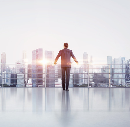 Photo pour Businessman standing on a roof - image libre de droit