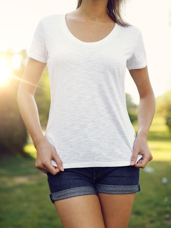 Woman wearing blank vest on the sunset