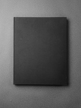 Photo pour Black book cover on the gray background. Vertical - image libre de droit