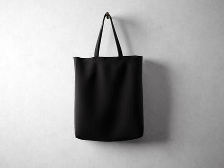 Photo pour Black cotton textile bag holding, neutral background. horizontal - image libre de droit