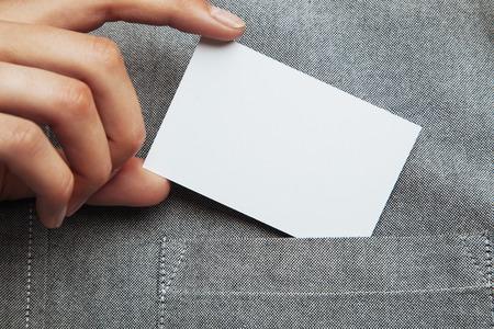 Photo pour Closeup of man putting blank business card in his pocket of shirt. Horizontal - image libre de droit