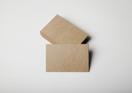 Photo pour Stack of empty craft business cards on white background with soft shadows. Horizontal - image libre de droit