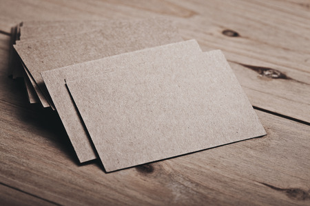 Photo pour Closeup of blank and craft business cards on natural wood table. Horizontal. Color. - image libre de droit