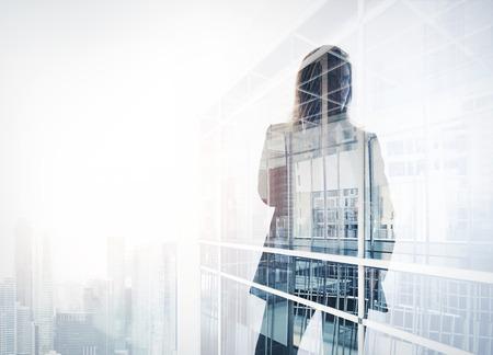 Photo pour Photo of businesswoman. Double exposure, city on the background. Blurred background - image libre de droit