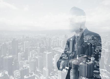 Foto de Photo of stylish adult businessman wearing trendy suit. Double exposure, panoramic view contemporary city background. - Imagen libre de derechos