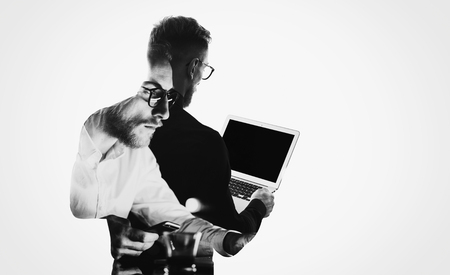 Photo pour Double exposure young bearded  banker wearing black shirt and holding contemporary notebook hands.Blank screen ready for you message.Isolated white,portrait man background. - image libre de droit