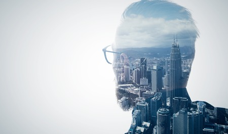 Photo pour Photo of stylish bearded lawyer wearing trendy suit and looking city. Double exposure, panoramic view contemporary megalopolis background. Space for your business message.  Isolated white. - image libre de droit