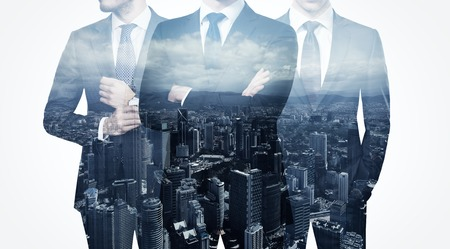 Photo for Photo of trio stylish adult businessman wearing trendy suit. Double exposure, panoramic view contemporary city background. Man power, leadership, isolated on white. - Royalty Free Image