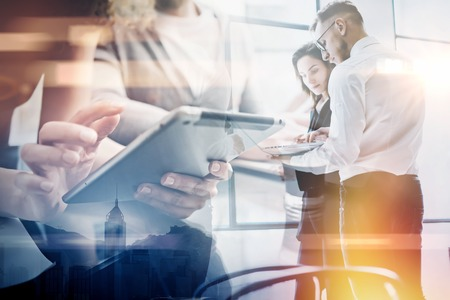 Photo for Business team work process.Double exposure photo professional crew working with new startup project.Investment managers meeting. Analyze business plans laptop.Blurred,film and bokeh effect. - Royalty Free Image