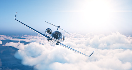 Photo pour Image of black luxury generic design private jet flying in blue sky at sunset. Huge white clouds background. Business travel picture. Horizontal . - image libre de droit