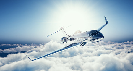 Photo pour Image of black luxury generic design private jet flying in blue sky at sunset. Huge white clouds background. Luxury travel concept. Horizontal. - image libre de droit
