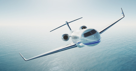 Photo pour Picture of white luxury generic design private jet flying over the empty sea. Blue sky at background. Luxury travel concept. Horizontal . - image libre de droit