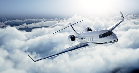 Photo pour Realistic photo of White Luxury generic design private jet flying over the earth. Empty blue sky with white clouds at background. Business Travel Concept. Horizontal. - image libre de droit
