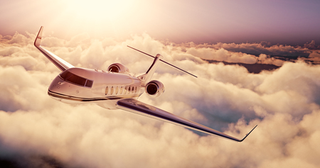 Photo pour Realistic picture of White Luxury generic design private airplane flying over the earth at sunset. Empty blue sky with huge white clouds  background. Business Travel Concept. Horizontal. - image libre de droit