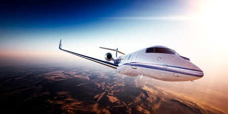 Photo pour Realistic photo of White generic design private jet flying over the mountains.Empty blue sky and sun at background.Business Travel by modern Luxury aircraft.Horizontal,side view closeup. - image libre de droit