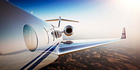 Photo pour Photo of White Luxury Generic Design Private Jet Flying in Blue Sky at sunset.Uninhabited Desert Mountains Background.Business Travel Picture.Horizontal,Film Effect. 3D rendering - image libre de droit
