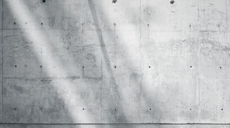 Foto de Horizontal Photo Blank Grungy Smooth Bare Concrete Wall with Sunrays Reflecting on Light Surface. Soft shadows. Empty Abstract background. Black and White. - Imagen libre de derechos