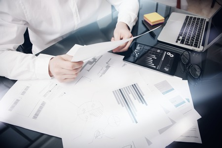 Risk Management Work process.Photo Trader working Market Report Documents.Use Electronic Device.Graphic Icons,Stock Exchanges Reports Screen Tablet. Business Project Startup. Horizontal, .