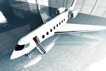 Photo pour Photo of White Glossy Luxury Generic Design Private Jet parking in hangar airport. Concrete floor. Business Travel Picture. Horizontal, top angle view. Film Effect. 3D rendering - image libre de droit