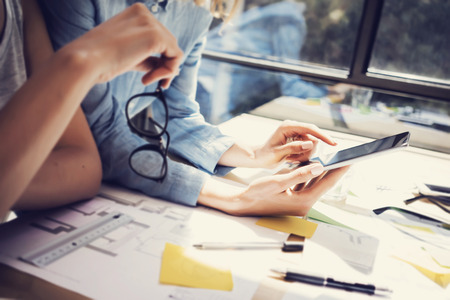 Successful Account Managers Team Analyze Business Reports Modern Interior Design Loft Office.Coworkers Using Contemporary Tablet.Sharing Information.Blurred Background.New Startup Idea Process