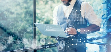 Photo for Concept Global Strategy Graph Virtual Icon Diagram.Innovations Searching Interface.Bearded Businessman Wearing Glasses White Shirt Waistcoat Typing Mail Modern Laptop His Hand.Blurred Background.Wide - Royalty Free Image