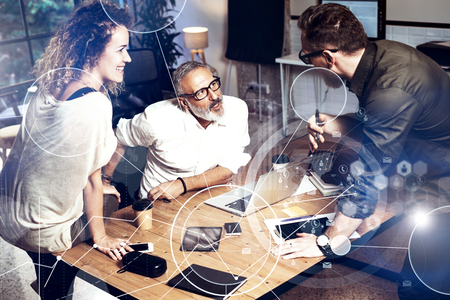 Foto de Concept of digital screen, virtual connection icon,diagram, graph interfaces.Bearded man talking with account director and creative manager.Business people meeting photo.Horizontal blurred - Imagen libre de derechos