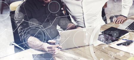Photo for Concept of digital screen,virtual connection icon,diagram, graph interfaces.Two mans using together laptop,working in new startup project.Business people teamwork process.Wide,film effect,blurred - Royalty Free Image