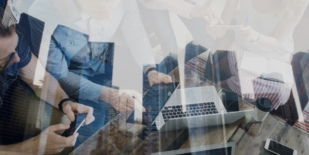 Photo for Double exposure of young coworkers working together on new startup project in modern office.Business people brainstorming concept.Skyscraper building on the blurred background.Wide,film effect - Royalty Free Image