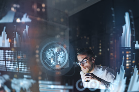 Photo pour Concept of digital diagram,graph interfaces,virtual screen,connections icon.Young entrepreneur working at modern office.Man using contemporary laptop at night,blurred background.Horizontal. - image libre de droit