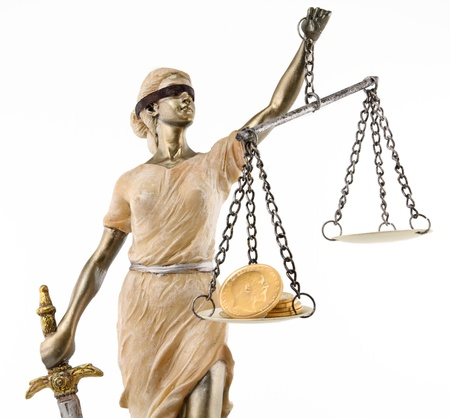 Justice  greek themis,latin justitia  blindfolded with scales, sword and money on one scale  Corruption and bribing concept