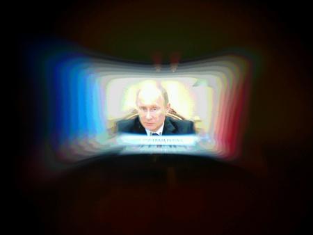 Russian President Vladimir Putin. Speech on TV on aesthetic lensbaby lens.