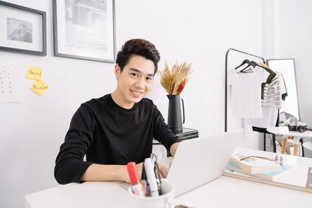 Photo pour Smart Young Asian Working - image libre de droit