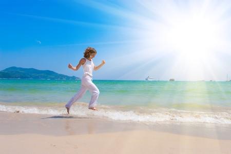 girl runs at the sea
