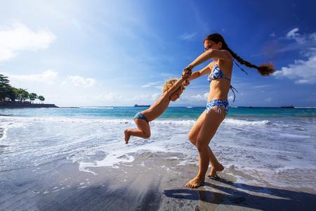 Photo pour A family is having fun at the seashore - image libre de droit