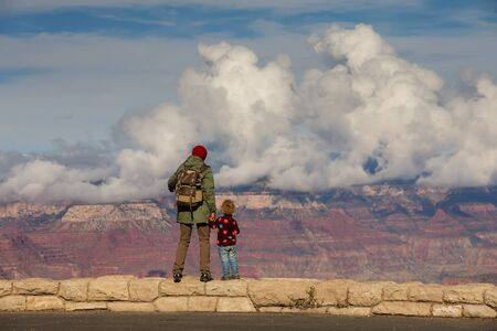 A man with his son are hiking in Grand canyon National Park