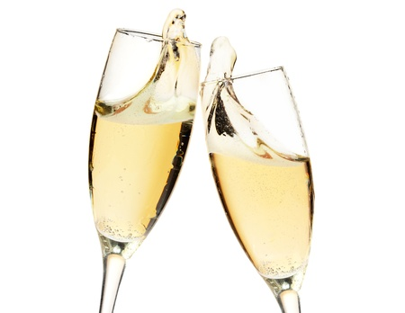 Photo pour Cheers! Two champagne glasses. Closeup, isolated on white - image libre de droit