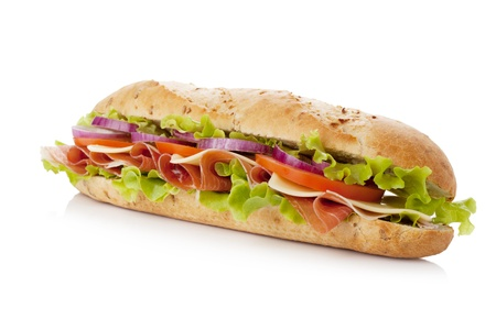 Long sandwich with ham, cheese, tomatoes, red onion and lettuce. Isolated on white
