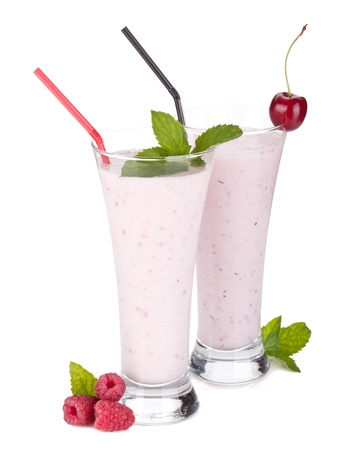 Raspberry and cherry milk smoothie with mint  Isolated on white background