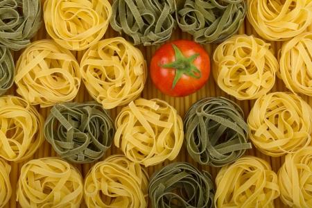 Italian colors pasta background with tomato