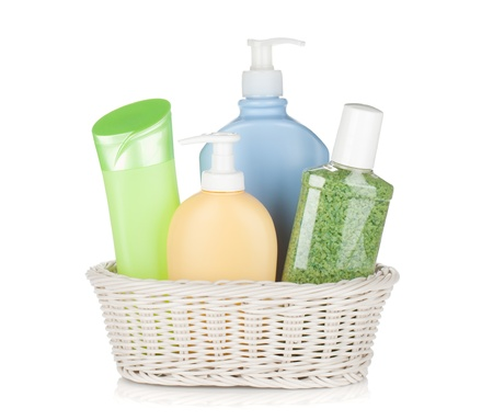 Cosmetics bottles in basket. Isolated on white background