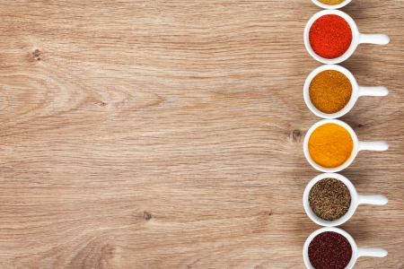 Various spices selection on wooden table