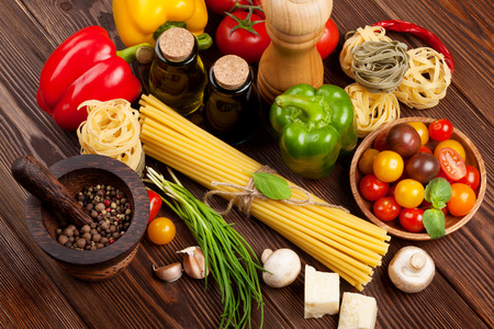 Italian food cooking ingredients. Pasta, vegetables, spices. Top view