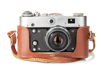Vintage film camera with leather case. Isolated on white background