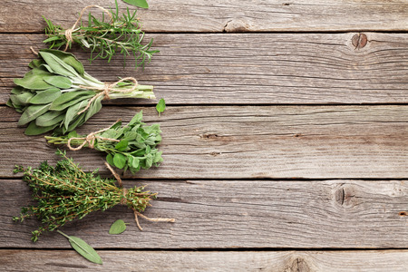 Photo for Fresh garden herbs on wooden table. Oregano, thyme, sage, rosemary. Top view with copy space - Royalty Free Image