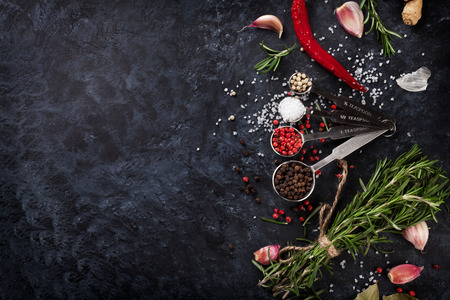 Photo for Herbs and spices over black stone background. Top view with copy space - Royalty Free Image