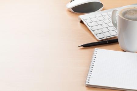 Foto de Office desk table with supplies and coffee cup. View with copy space - Imagen libre de derechos