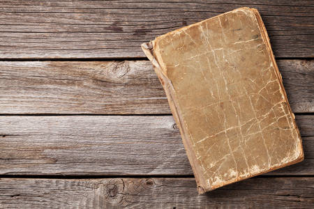 Photo for Vintage book on wooden background. Top view with copy space - Royalty Free Image