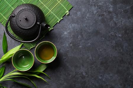 Photo pour Green japanese tea on stone table. Top view with copy space - image libre de droit